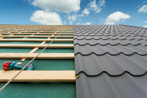 Roof with metal tile,screwdriver and roofing iron